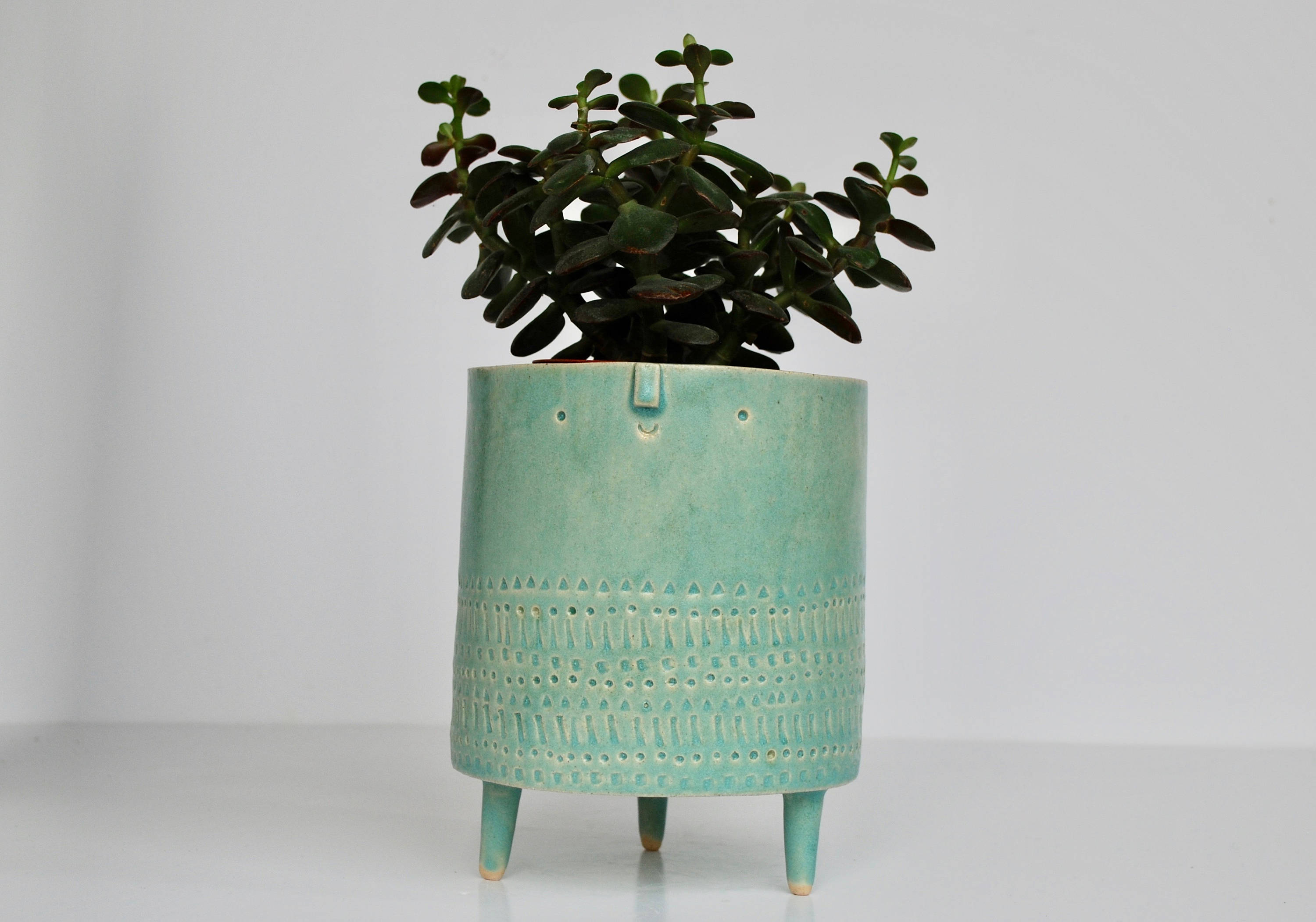 turquoise green tripod planter pot by atelier stella ceramics