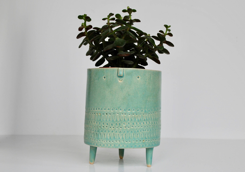 turquoise green tripod planter pot by atelier stella ceramics